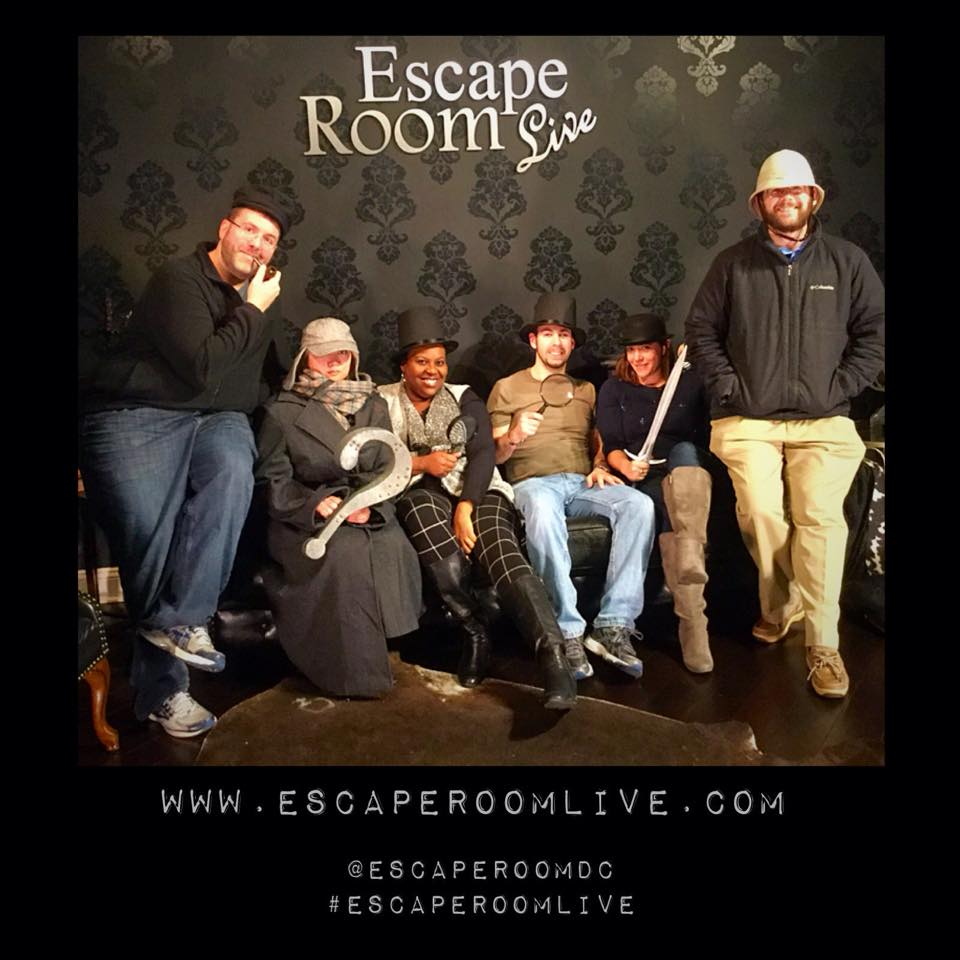 Team Disturbed Friends (Mike, Steph, Dalia, Jason and Rohan) defeated the infamous Dr. Moriarty! Photo courtesy of Escape Room Live's Facebook page.